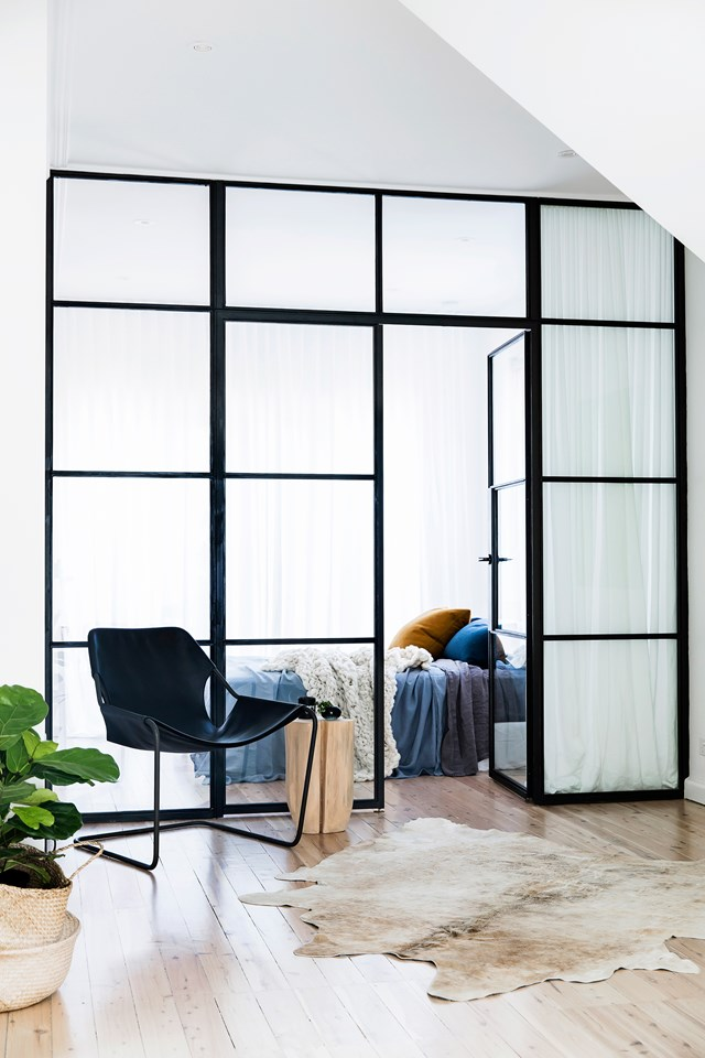 "Steel-framed glass doors are a standout feature in this [renovated family home](https://www.homestolove.com.au/expert-renovation-and-interior-design-advice-5811|target=""_blank""). *Photo:* Maree Homer"
