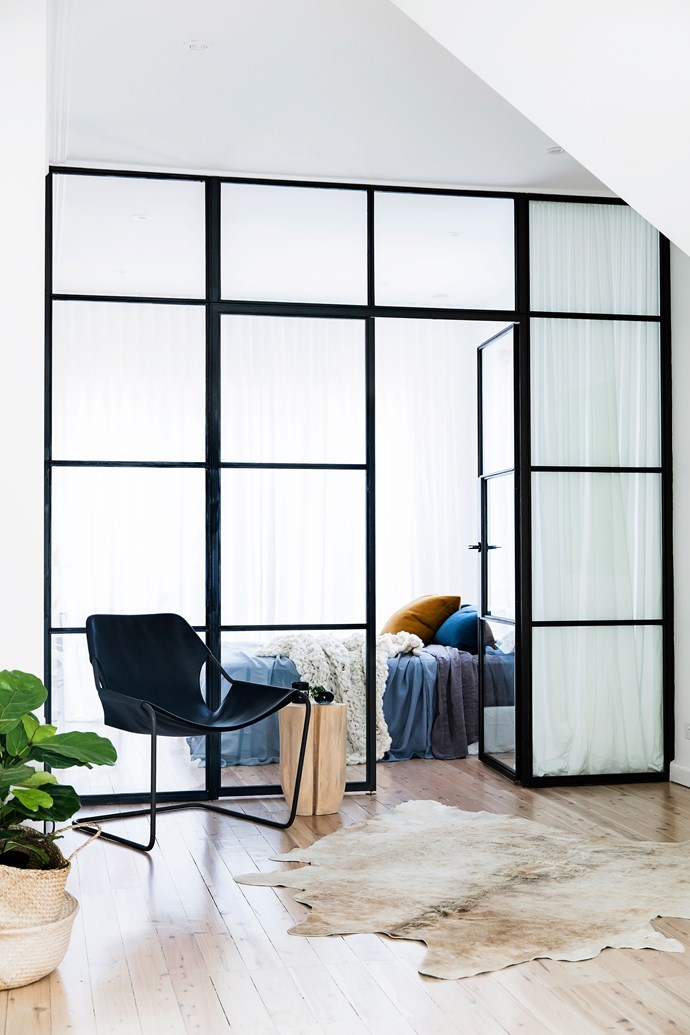 The owners were keen to use black steel-framed windows somewhere in the home. These Skyrange windows created a multifunctional space used as a fourth bedroom, study and playroom. The heavy linen curtains from Simple Studio provide privacy.