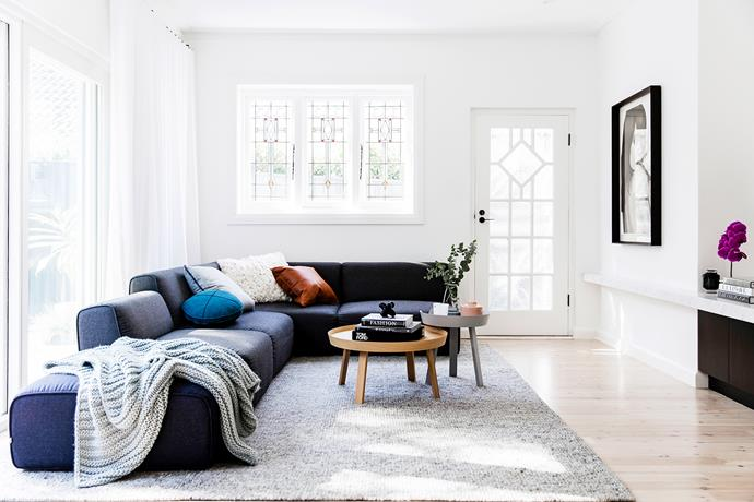 The owners decided to keep their private entryway despite it opening into the living room rather than use the shared path with the adjoining house. The sofa is from Jardan; the Muuto coffee tables are from Living Edge.