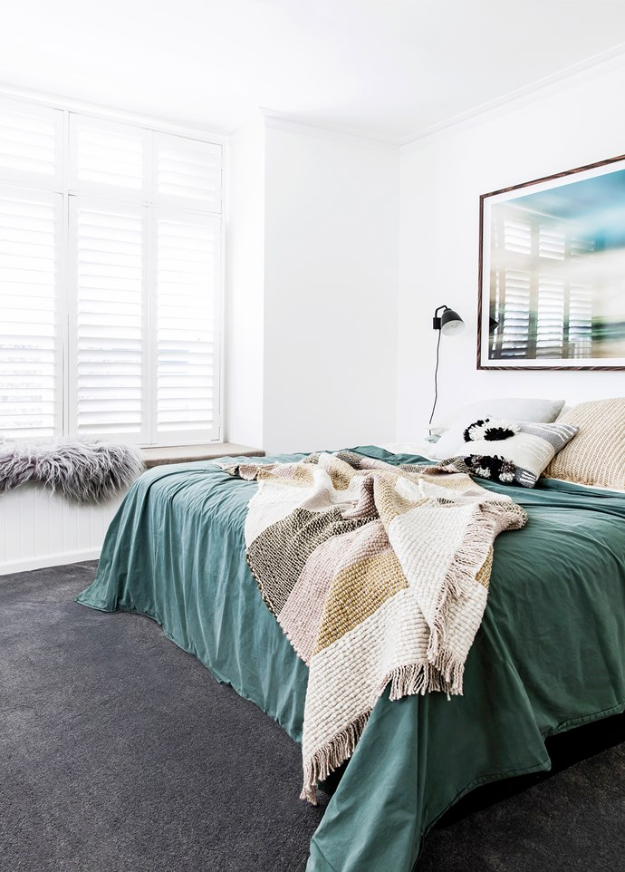 Wall lights by Cecilie Manz from Cult Design flank the bed in the light and bright master room.