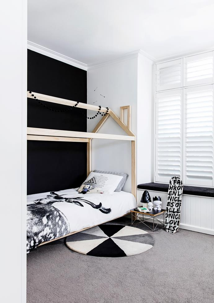 This cute house bed from Norsu is a fun addition to Oscar's room. A bench under the window seat and toy storage in the wardrobe helped to create a clutter-free space.