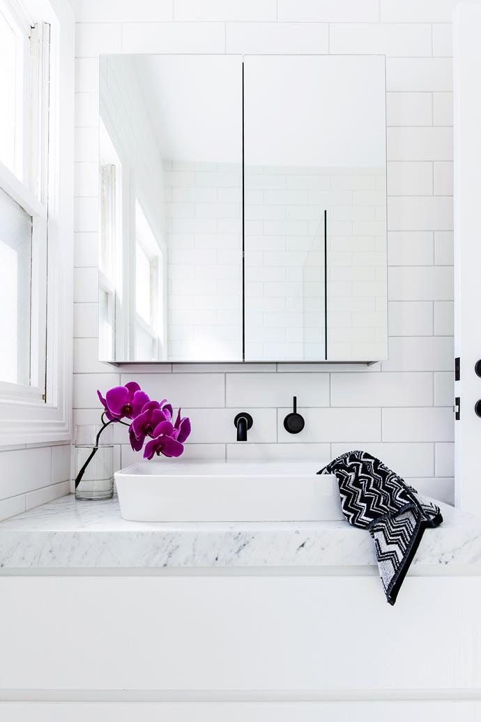 Natural light reflects beautifully off the crisp white palette in the bathroom.