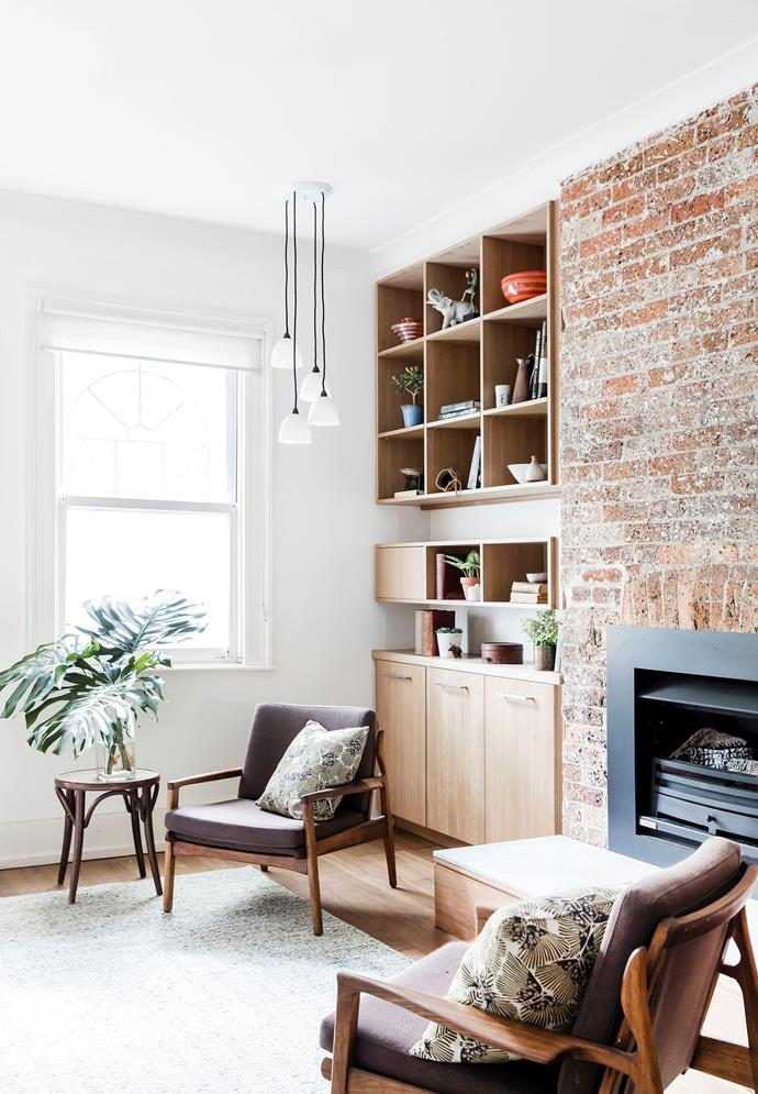 Heritage restrictions meant keeping the original fireplaces. This one now features a Jetmaster heater with a contemporary surround, while those elsewhere in the house have become storage spaces.