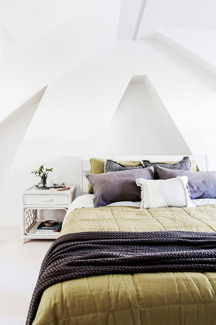 In this new bright-white attic room, the structural framework of the house has been turned into a design feature.