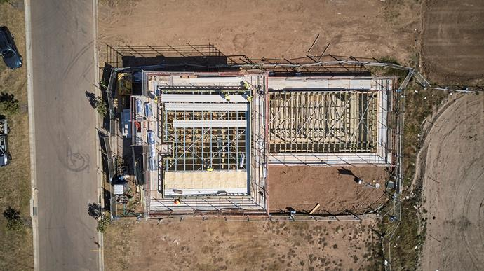 """**OCTOBER 4, 2017: THE ROOF IS ON** <br><br> Another significant milestone has been reached in the My Ideal House build at Crest by Mirvac: the roof is now on. Roof trusses were set in place in September and the scaffolding put up to allow access to every part of the frame and roof.  Sydney architect Madeleine Blanchfield won the My Ideal House design competition with her wonderfully flexible and modular design. One of the key aspects of her design is its [Colorbond](http://colorbond.com/