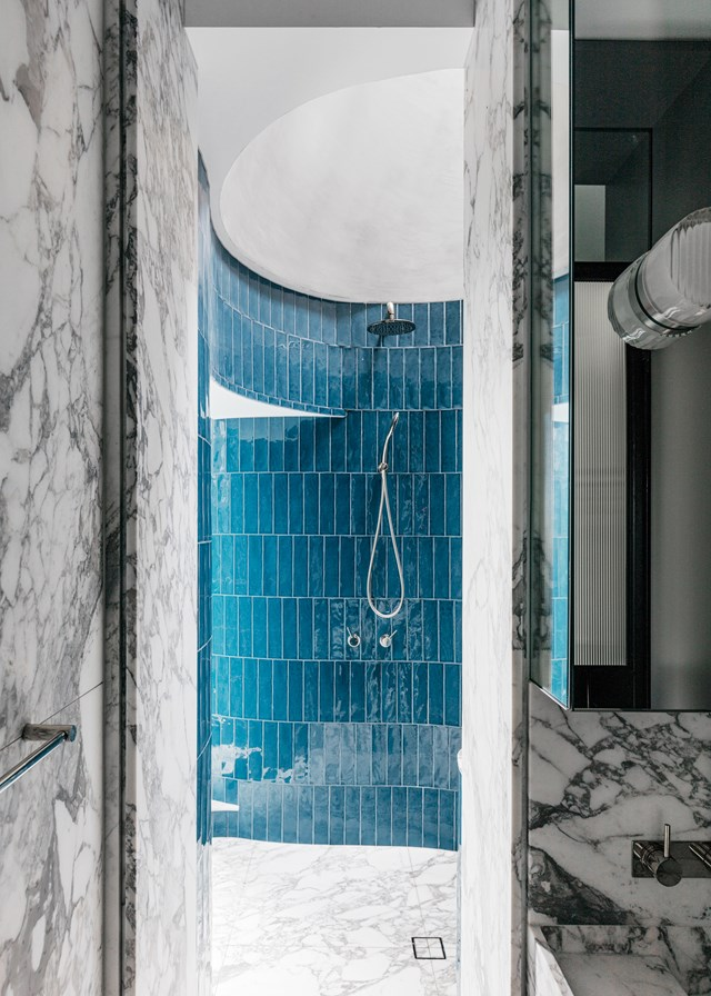 "Denim tiles from Surface Gallery have been used to create a colourful counterpoint to the floor-to-ceiling marble used in this bathroom in a [penthouse apartment in Sydney](https://www.homestolove.com.au/a-rooftop-sydney-apartment-and-garden-5877|target=""_blank""). Mixing blocks of bold colour with classic materials such as marble is a good way to experiment with fun shades without going overboard."