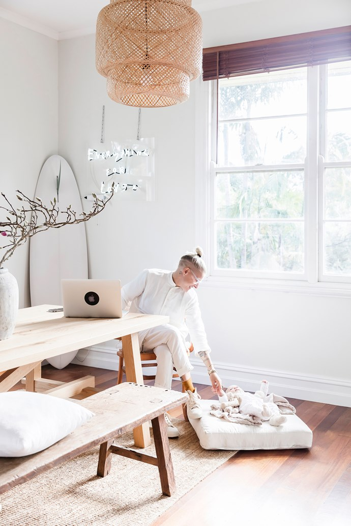 """The neon """"Everything for Love"""" sign features prominently in the dining space. """"It was designed by a close friend and made for our wedding,"""" Lotte says. """"It's an ongoing reminder of our love."""""""