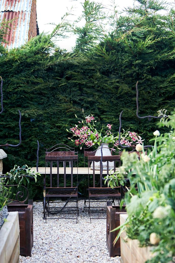 Debbie and Cameron host regular gatherings in this sheltered kitchen garden. The 4m-high 'Leighton Green' cypress hedge is 10 years old and screens the northern boundary of the property. The ground is covered in local limestone gravel.