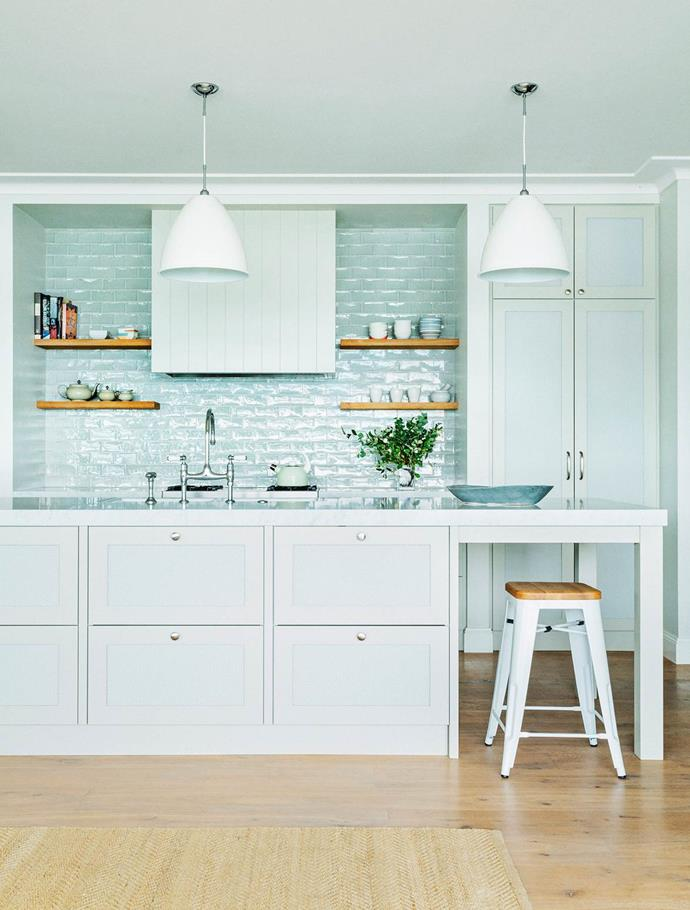 "A minty fresh splash back and detailed panelled joinery elevates this [breezy country kitchen](http://www.homestolove.com.au/shop-the-look-modern-country-kitchen-4897|target=""_blank""