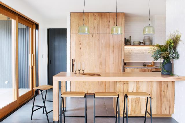 Proving you can never have too much timber, this [modern kitchen in Adelaide Hills](http://www.homestolove.com.au/modern-timber-kitchen-by-fabrikate-creative-spaces-5185) is both visually striking and endlessly functional. A camouflaged fridge and hidden sink area allows the owners to conceal the mess of food preparation and used dishes while entertaining.  *Photo: Joslin Koolen*