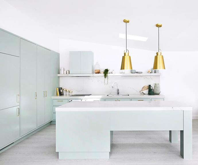 This ethereal ['un-kitcheny' kitchen in Sydney's Hills](http://www.homestolove.com.au/pastel-green-kitchen-by-three-birds-renovations-5209) district uses ceasarstone (an affordale alternative to real marble) and mixed metallics against a muted green cabinetry to create an electic, and subtly futuristic, cooking space. *Photo: Three Birds Renovations*