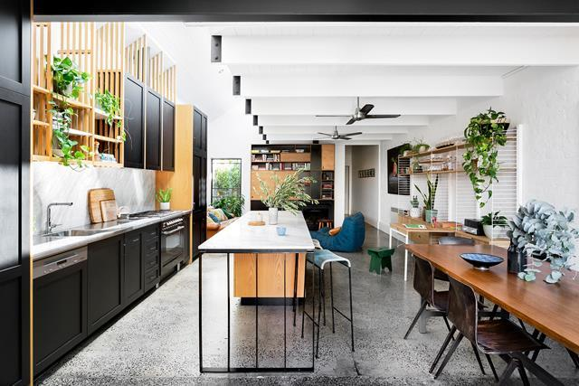 Tucked behind a picket fence and a stand of magnolias in Melbourne's inner north, this [transformed worker's cottage](http://www.homestolove.com.au/space-savvy-renovation-of-an-old-workers-cottage-5322) in Melbourne boasts a  luminous new kitchen with an open-plan living zone, Calacatta marble surfaces and American oak joinery in a mix of natural and inky hues. *Photo: Martina Gemmola*