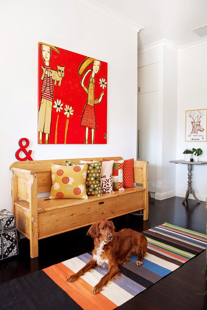 Adding pops of colour to your home's entrance is easy with colour-matched accessories. *Photo: James Knowler*