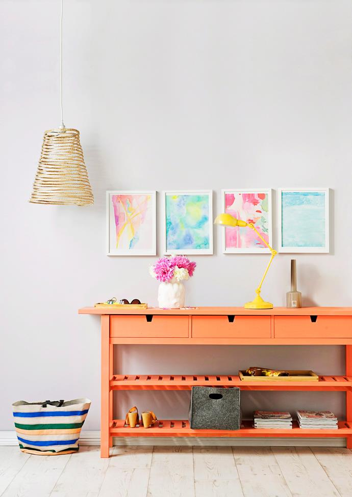 Hanging artwork above the hallway brings this space to life – these framed prints feature the pastels echoed throughout the space. *Photo: Tony Amos*