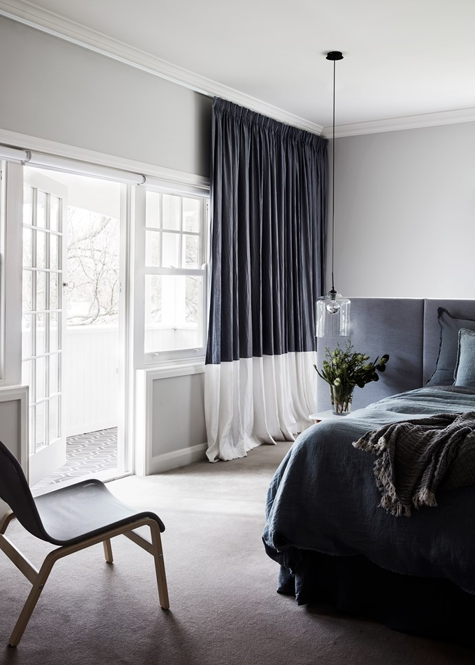 In the main bedroom are two-tone custom curtains by Lynch's Window Fashions. 'Lust' pendant light from About Space. Hale Mercantile Co. bed linen.