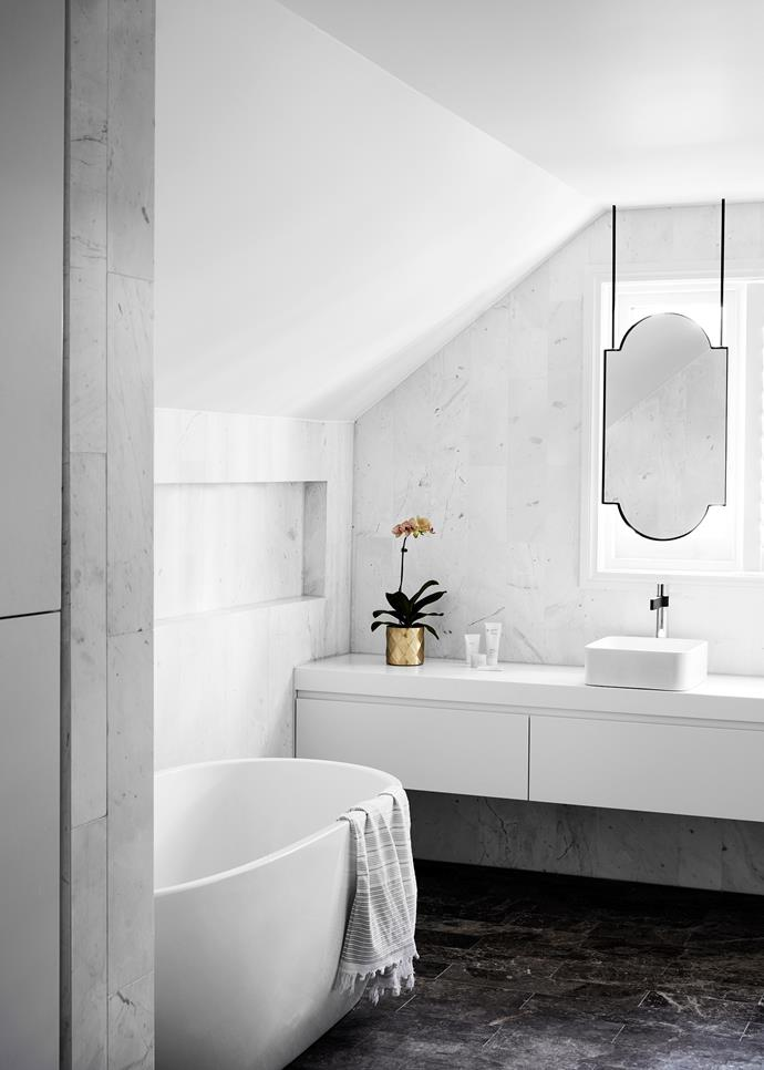 The bathroom mirror was inspired by the shape of the original leadlight windows. Reece 'Clearwater Formoso' freestanding bath.