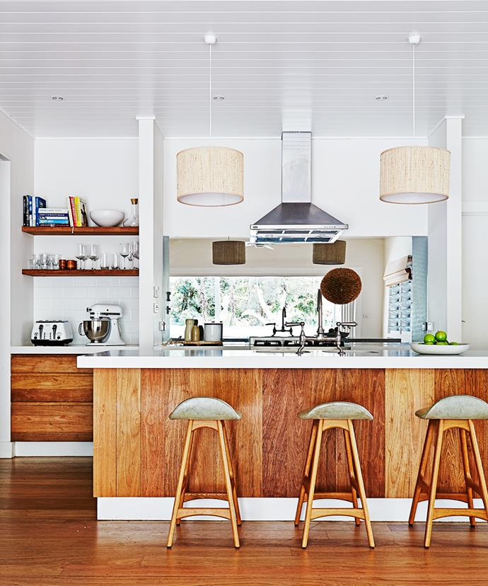 The kitchen in this backpackers-turned-family home is decked out in American oak, so it has a decidedly warm palette. The window splashback complements it well, giving the space an [airy quality](https://www.homestolove.com.au/10-timeless-timber-kitchens-4678). <br><br>  *Photographer: Alicia Taylor / Real Living*