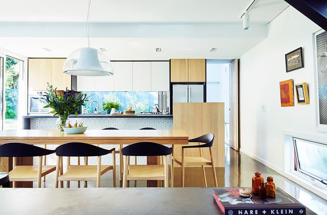 This timeless kitchen uses a [window splashback](https://www.homestolove.com.au/granny-flat-economises-a-new-house-build-in-manly-4940) to complement naturalistic timber with garden views. <br><br>  *Photographer: John Paul Urizar / Australian House & Garden*