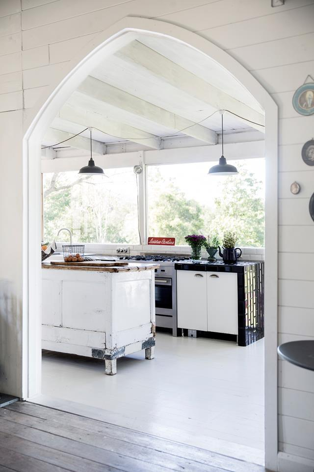 This [kitchen](https://www.homestolove.com.au/a-converted-19th-century-church-on-the-hawksberry-river-5132) sits in a converted church on the bank of the Hawkesbury River, and juxtaposes rustic interiors with a view of cool-toned Australian natives. <br><br>  *Photographer: Chris Warnes / Australian House & Garden*