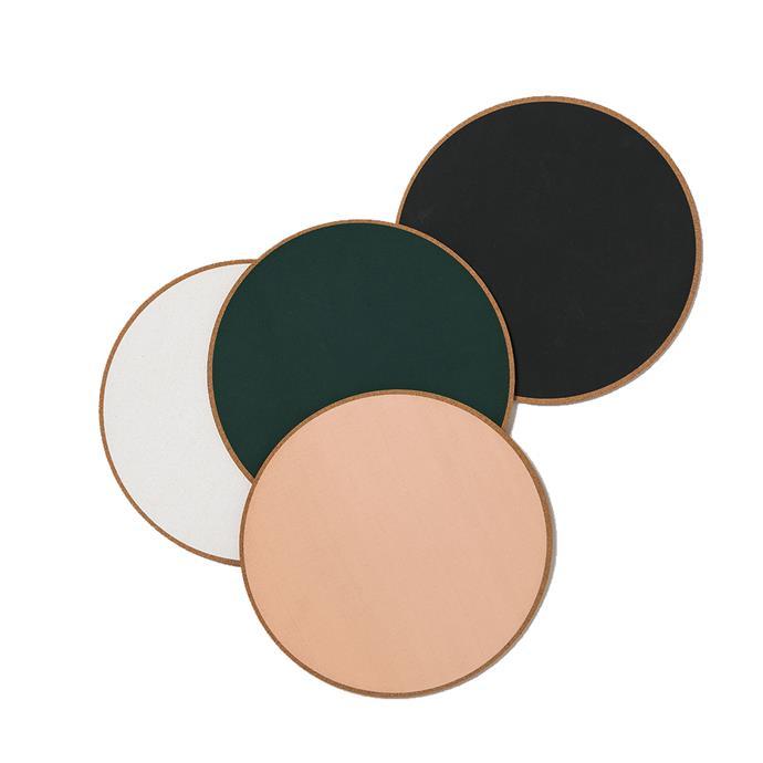 "Monroe Round Cork Placemats, $12, [Citta Design](https://www.cittadesign.com/house-home/kitchen-dining/napkins-placemats-tablecloths/monroe-round-cork-placemat-zni0019|target=""_blank""|rel=""nofollow"")."