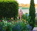 A formal cottage garden filled with earthly delights