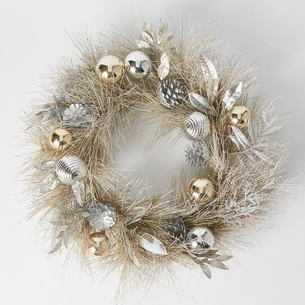 """Welcome family and friends into your home with this elegant silver and gold wreath. <br><br> Christmas luxe wreath available from [Target](https://www.target.com.au/p/christmas-luxe-wreath/P60571595
