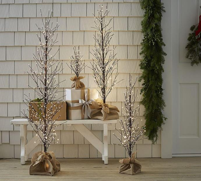 """Bring a touch of sparkle and magic to any corner of your home with these light up trees. <br><br> Faux lit berry tree available from [Pottery Barn](http://www.potterybarn.com.au/lit-berry-tree