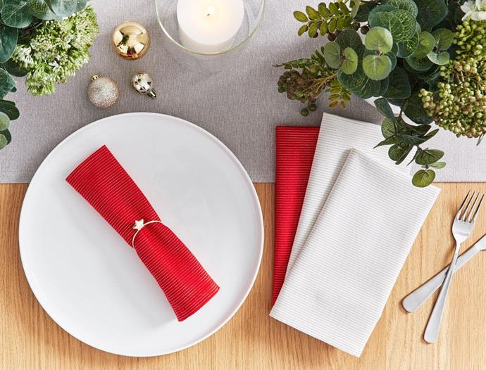 """If you love a traditional Christmas red but are wary of going overboard, this lovely set of red and beige napkins with gold detailing, will give your table setting just the right amount of colour. <br><br> Lurex stripe napkin (set of four) available from [Bed Bath N' Table](http://www.bedbathntable.com.au/19627002