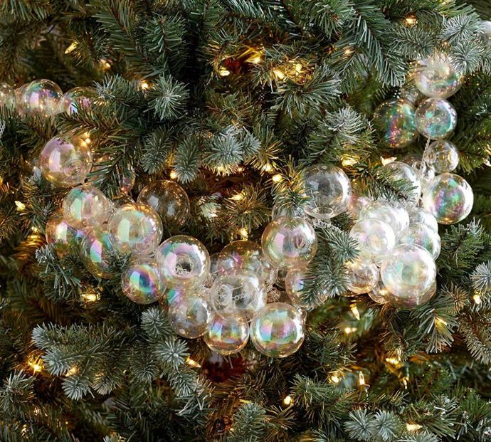 """Step away from the tinsel! This opal bubble garland will add a sophisticated sparkle to any Christmas tree or colour scheme. <br><br> Opal bubble garland available from [Pottery Barn](http://www.potterybarn.com.au/opal-bubble-garland