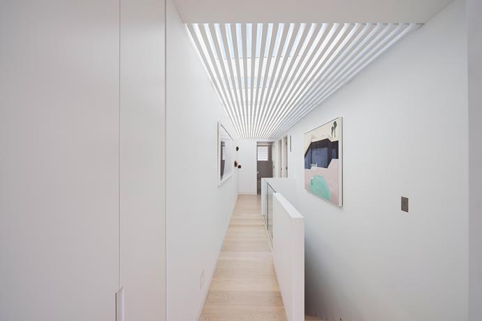 An extended skylight adds an airy, spacious quality to an otherwise narrow hallway.