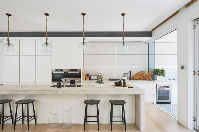 The airy kitchen boasts a limestone island beach, a concealed Liebherr fridge and Miele appliances throughout.