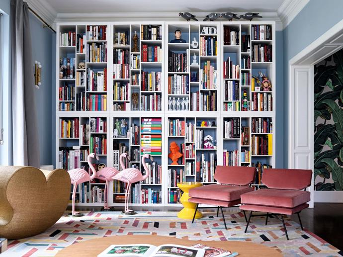 "Minimalism is not a concept to be found here – hundreds of books and comics, pink flamingos and artworks, from the likes of Murakami and Jeff Koons, jostle for space. The couple chose statement patterns and strong colours for their apartment, mixing contemporary style with kitsch collectibles. [Take a tour of this colourful Milanese home here](https://www.homestolove.com.au/a-colourful-and-kitsch-milan-apartment-5641|target=""_blank""). Photo: Fabrizio Ciccon / *Real Living*"