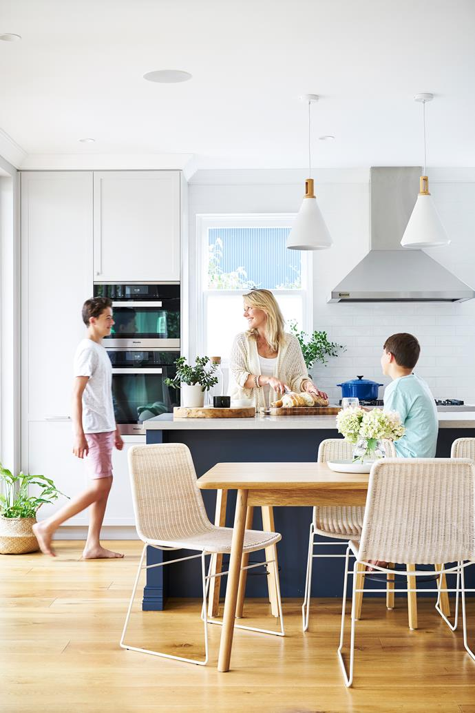 Owner Nicola Lacey wanted her beautiful blue kitchen island to be the centrepiece of the home. Designer Helen Carter specified a 2.9m-island bench without a sink so it could be used by the entire family at the same time. The colour is Dulux Pit Stop.