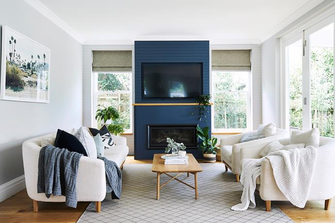 Making the fireplace into the room's new focal point has lengthened the space considerably. An oak shelf between the Regency 'Greenfire' gas log fire and Samsung flat-screen TV breaks the mass and prevents heat from rising directly up. Sofa and occasional chairs, from Orson & Blake.
