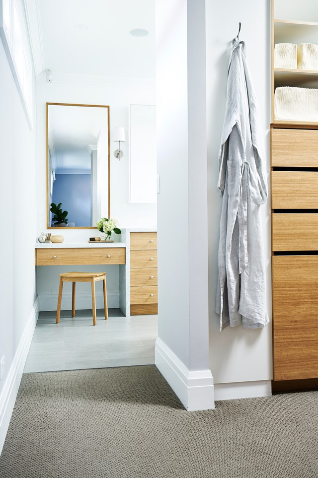 "The mix of timber cabinetry on a fresh palette makes [this walk-in wardrobe](https://www.homestolove.com.au/modern-revamp-of-a-1920s-california-bungalow-5986|target=""_blank"") a calming sanctuary to get ready. *Photo: John Paul Urizar 