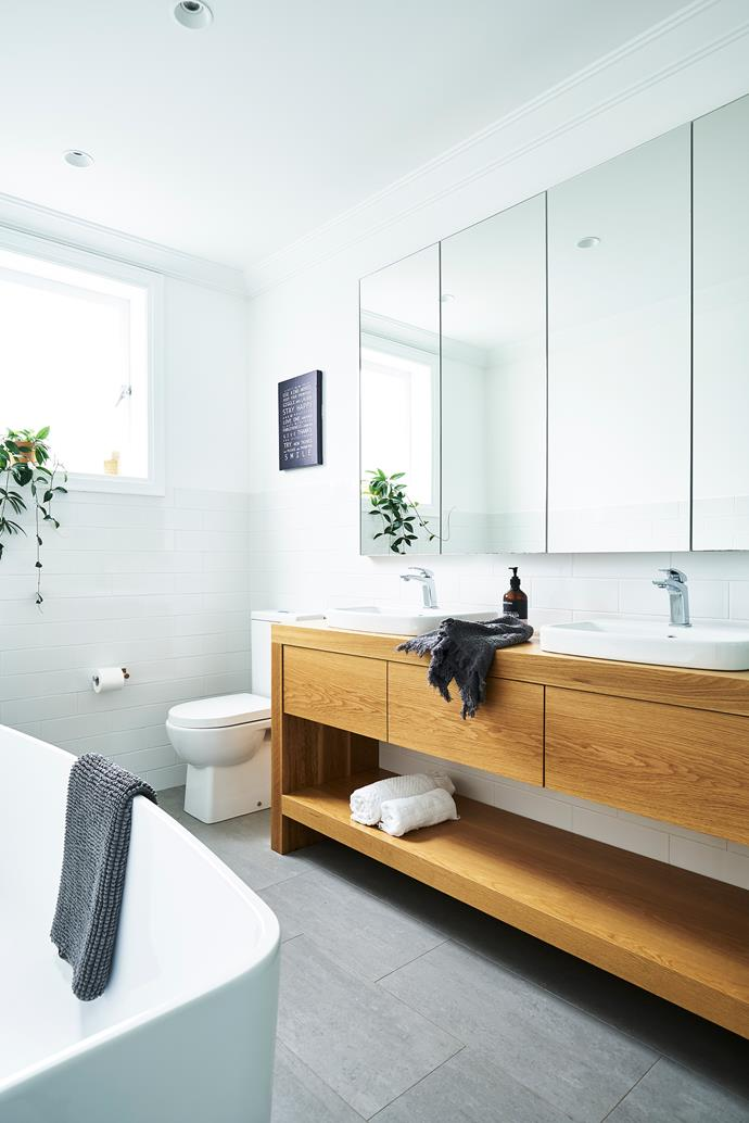 The new family bathroom is the perfect-sized space for growing boys. Custom oak vanity with Caroma sinks and bath. Large-format floor tiles, from Better Tiles.