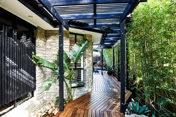 A tropical boardwalk creates an inviting entry.