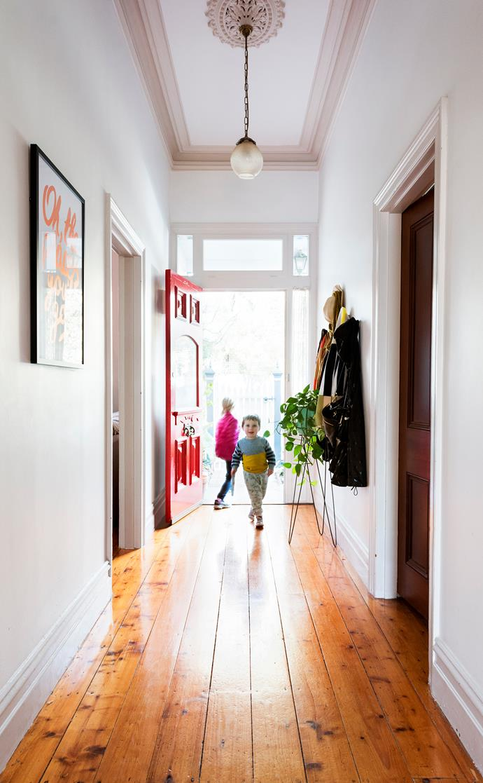 A bright red front door adds to the original charm of this Melbourne weatherboard.