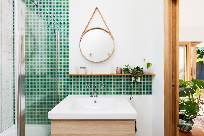 Green tiles in the bathroom help to bring the outdoors in.