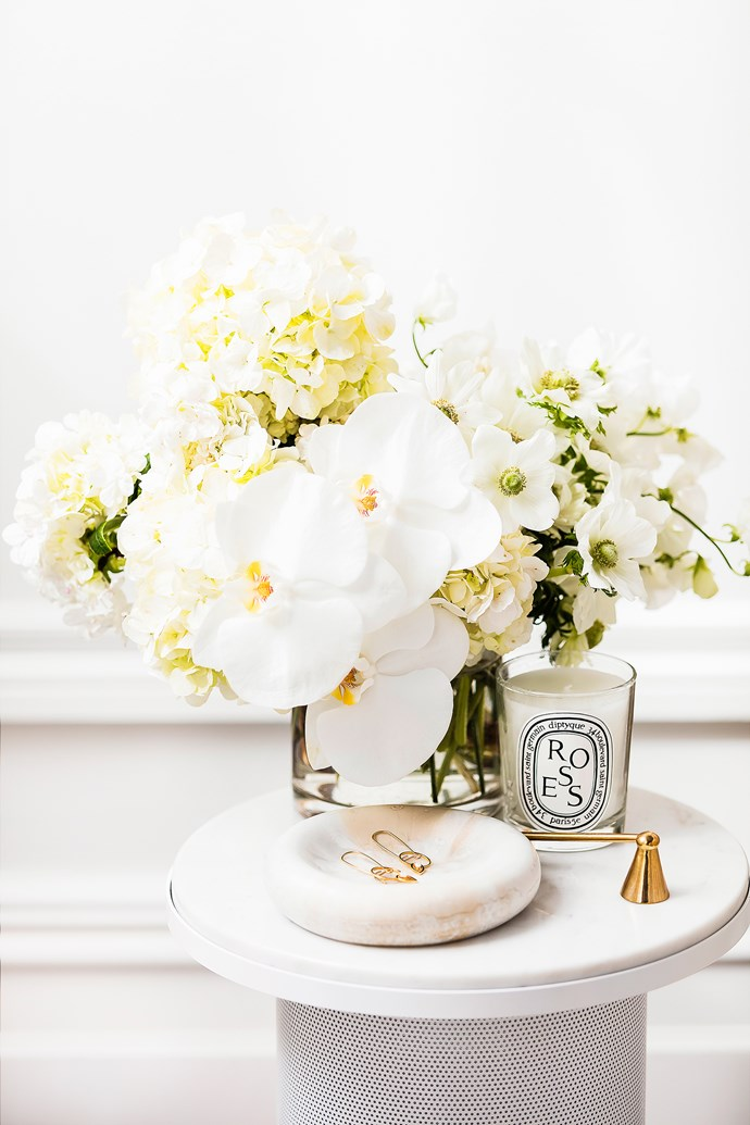 Diptyque Roses candle. Medium mother of pearl dish in Sandy Pearl, $70, from Dinosaur Designs. Earrings, $139, from Samantha Wills.