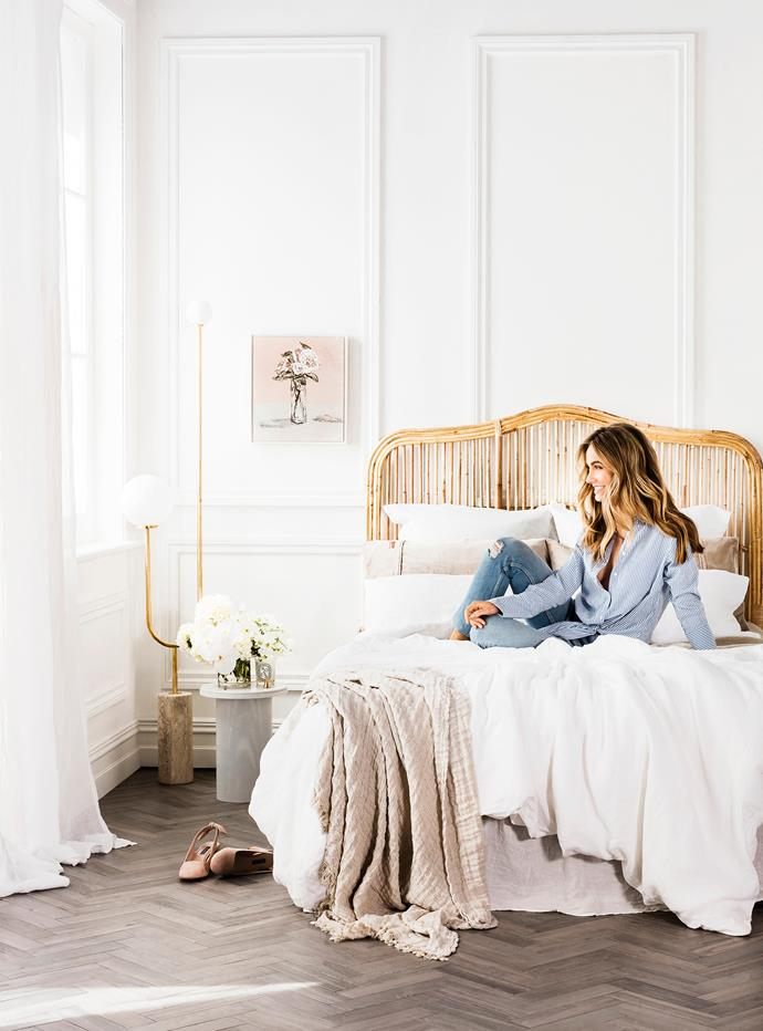 Brookhaven cane bedhead in Natural, $599 for queen, Naturally Cane. Esaila Pedestal side table in White, $649, The Minimalist. ON BED Linen duvet set in White, $355 for queen, Linen fitted sheet in Natural, $170 for queen, and Linen flat sheet in Natural, $190 for queen, from Cultiver.