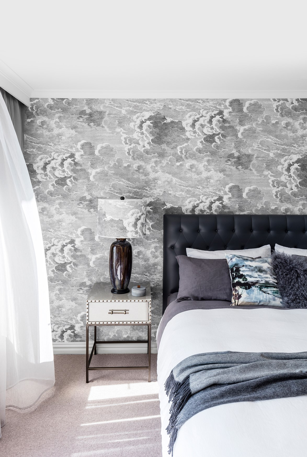 "This bedroom, [designed by Ioanna Lennox Interiors](https://www.homestolove.com.au/house-and-garden-top-50-rooms-2017-bedrooms-6006|target=""_blank"") is made calm and cosy by a combination of the cool grey colour scheme as well as the dreamy, cloud-like wallpaper. *Photo: Felix Forest / Story: Australian House & Garden*"
