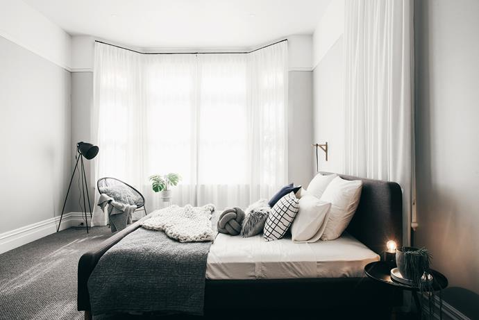 """**Cloud Nine by [Lydia Maskiell Interiors](https://www.instagram.com/lydiamaskiellinteriors/ target=""""_blank"""" rel=""""nofollow"""")**  A soothing warm grey paint shade (see notes above) was the starting point for this Launceston bedroom. The owner wanted a calm space to retreat to after demanding days. Lydia restored the walls and trim of the century-old room, raising the focus with white above the picture rail. Floor-to-ceiling curtains accentuate the volume of space and filter light. Subtle lighting and luxe materials (wool, faux fur, velvet and a chunky knit) provide softness and luxury. """"It makes me feel relaxed,"""" says the owner. *Photography: Anjie Blair*"""