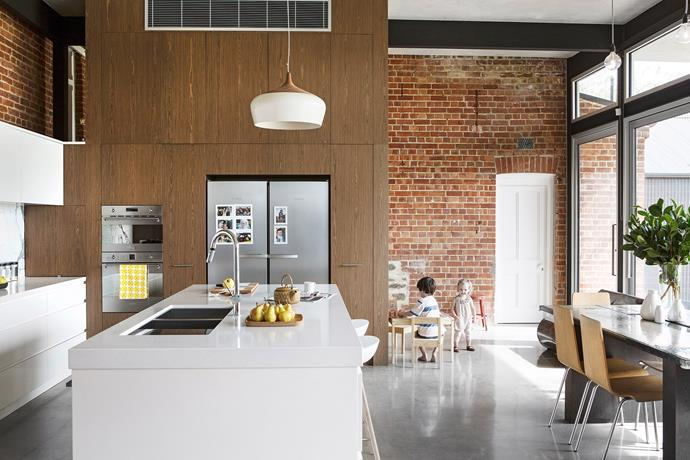 The open plan design has created a seamless dining experience, linking the food preparation space to serving area. *Photo: James Knowler / Australian House & Garden*