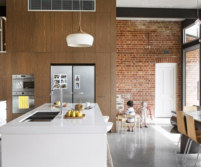 open plan kitchen dining with stainless steel fridge