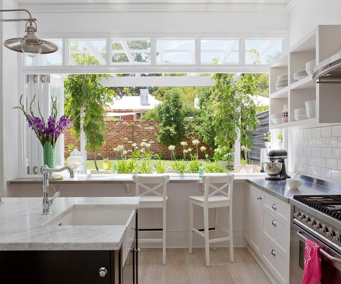 In this Perth cottage, bifolds were installed in the kitchen that opens to a servery, looking onto the gazebo beyond. Taking in views to the pool and garden, it's a beautiful place to relax, chat and eat. *Photo: Angelita Bonetti*