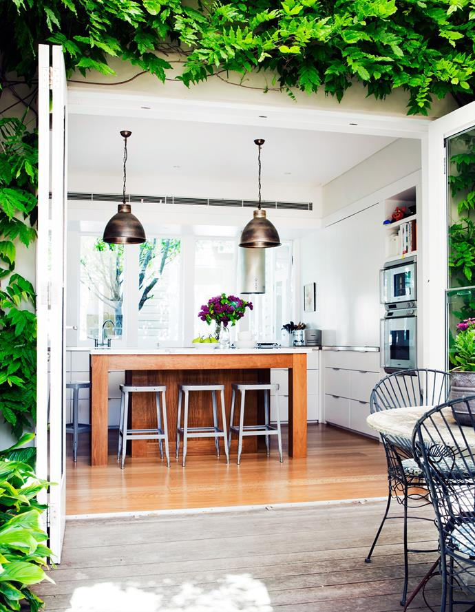 It's hard not to fall in love with this entertainer's kitchen, which also opens out to a private dining courtyard. *Photo: Maree Homer*