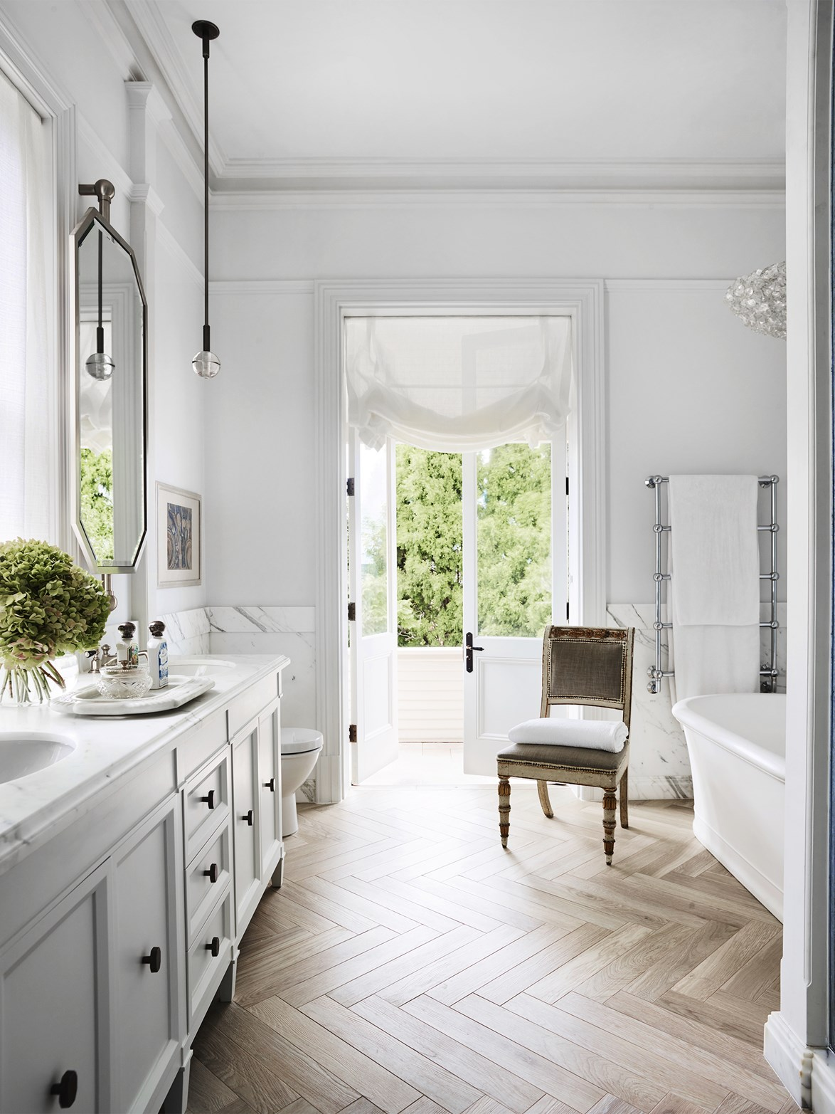 "**Timber look tiling** - More than ever, ensuite bathrooms are being seen as an extension of the master bedroom: a place to retreat and unwind. One way to achieve flow between rooms is by a) adopting an [open-concept bedroom and bathroom](https://www.homestolove.com.au/are-bathtubs-in-bedrooms-the-next-big-design-trend-6824|target=""_blank"") (which, let's face it, isn't for everyone) or b) keeping the flooring consistent across both spaces. That's where wood-look tiling comes in. Wood always adds warmth and, when laid in a herringbone pattern, feels very Parisian-chic. *Photo: Anson Smart / Story: Belle*"