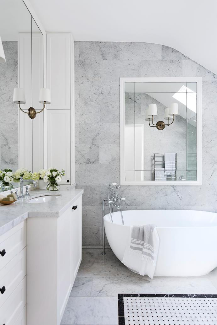 The exquisite Carrara marble wall and floor tiles from Marble & Ceramic Corp distinguish this space.