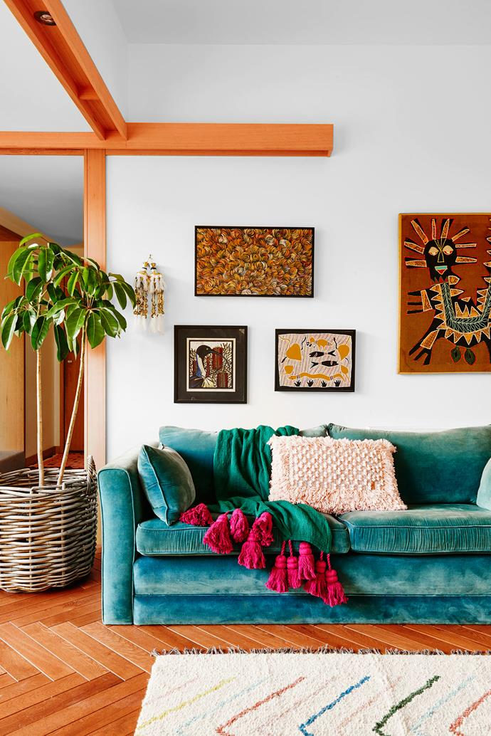 The main living area is home to a comfy, velvet-covered couch and eye-catching artworks including one by Aboriginal artist Margaret Scobie.